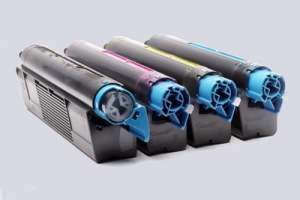 Four used color laser printer toner cartridges