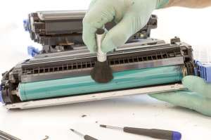 hands cleaning toner cartridge